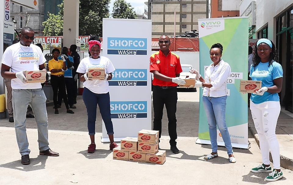 Vivo Energy Kenya Marketing Manager 3rd left and Vivo Energy Kenya Communications Manager 4th left handing over soap bars to Shining Hope for Communities (SHOFCO ) Mathare section for distribution into Mathare area in Nairobi.